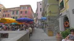 Outdoor restaurant with colorful umbrellas in Vernazza, Cinque Terre Stock Footage