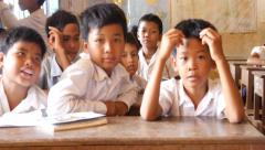Stock Video Footage of School children learning in classroom 4k Cambodia Asia happy smiling
