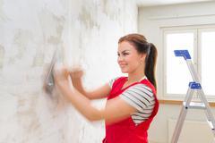 Woman grinding wall - stock photo