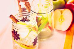 Stock Photo of Infused apple water with cinnamon and anise