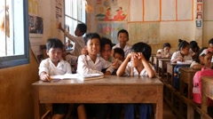 School children learning in classroom 4k Cambodia Asia happy smiling - stock footage