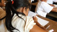 School children homework writing learning in classroom 4k Cambodia Asia Stock Footage