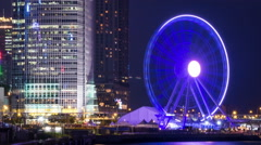 Timelapse with Ferris Wheel in night Hong Kong. Stock Footage