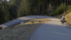 Motor Cyclist riding a twisting street - stock footage