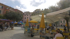 Square with restaurants in Vernazza, Cinque Terre Stock Footage