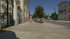 Walking on Krakowskie Przedmiescie, next to Potocki Palace in Warsaw Stock Footage