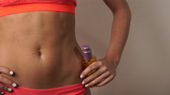 Woman with bottle of body oil lotion 4K. Stock Footage