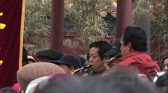 Waving red fans, brass band, music, China Stock Footage