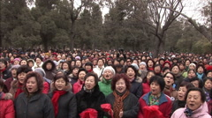 """Chinese crowd singing """"I Love China"""" in park Stock Footage"""