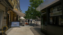 Passing by Green Caffe Nero and Wkrotce Otwarcie outdoor restaurant, Warsaw Stock Footage