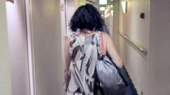 Girl walks quickly in the hallway of a cruise ship Stock Footage