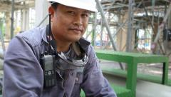 Portrait of man in refinery plant - stock footage