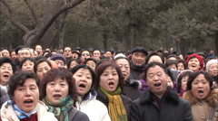 Chinese crowd singing traditional song Stock Footage