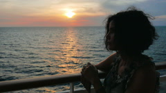 Meditative young woman on the deck of a voyage boat, sunset Stock Footage