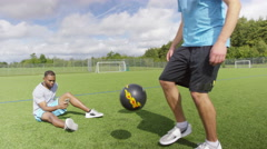 4K Talented young soccer players showing off ball skills & gymnastic ability - stock footage