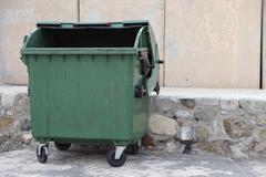 Empty trash dumpster - stock photo