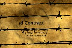 Contract on paper hole against barbwire Stock Photos