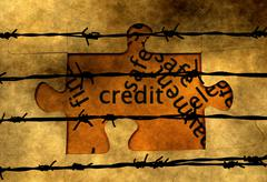 Credit puzzle concept against barbwire Stock Photos