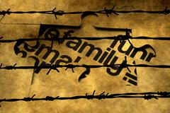 Family puzzle concept against barbwire Stock Photos