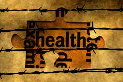 Health puzzle concept against barbwire Stock Photos