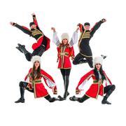 Stock Photo of dancer team wearing a folk Caucasian highlander costumes jumping