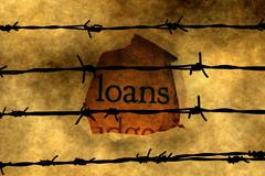 Loan concept against barbwire Stock Photos