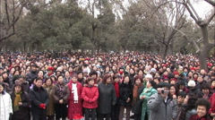 Chinese National Anthem, crowd singing Stock Footage
