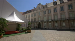 White tent with red carpet in front of it at the Royal Castle courtyard, Warsaw Stock Footage