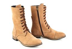 Women's brown boots with laces - stock photo