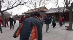 Chinese line-dancing, Chinese buildings Stock Footage