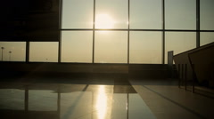 Silhouettes of people coming for a landing on the flight in Milan airport Stock Footage
