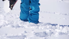 Snowboarder Stepping Through Deep Snow Stock Footage