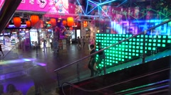 A shopping underground full of neon lights Stock Footage