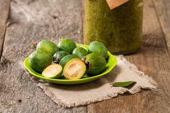 Fresh fruits of feijoa and feijoa jam Stock Photos