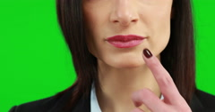 Businesswoman putting her finger on her lips - stock footage