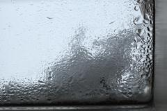 Closeup of humidity at a window - stock photo