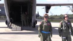 Two Female Flight Nurses Walk Away from Hercules C-130 Stock Footage