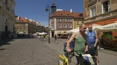Walking near the Church of the Holy Spirit on Nowomiejska street in Warsaw Stock Footage