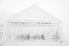 Snow and ice covered house after blizzard at winter Stock Photos