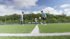 4K Talented young soccer players showing off their ball skills on soccer pitch Stock Footage