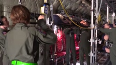Mock drill-Nurses Load 'Wounded' Mannequin on Board Hercules C-130 Stock Footage
