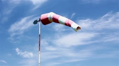 The control of a wind direction, windsock inflated by the wind on the cloudy sky Stock Footage