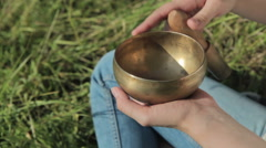 Young beautiful lady relaxing with nepal singing bowl Stock Footage