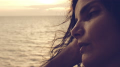 Nostalgic girl looks sadly at the sea Stock Footage