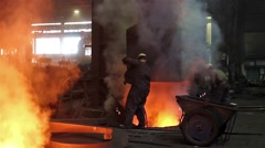 Stock Video Footage of Workers operate in blast furnace workshop of the metallurgical plant, foundry.
