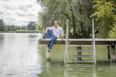 Stock Photo of man at the lake