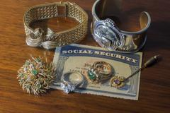 Social security card with jewelry Kuvituskuvat