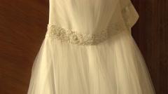 Hanging beautiful wedding dress Stock Footage