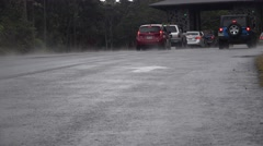 Stock Video Footage of tilt up, cars entering Volcano National Park    ,Hawaii