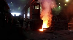 Workers operate in blast furnace workshop of the metallurgical plant, foundry. Stock Footage